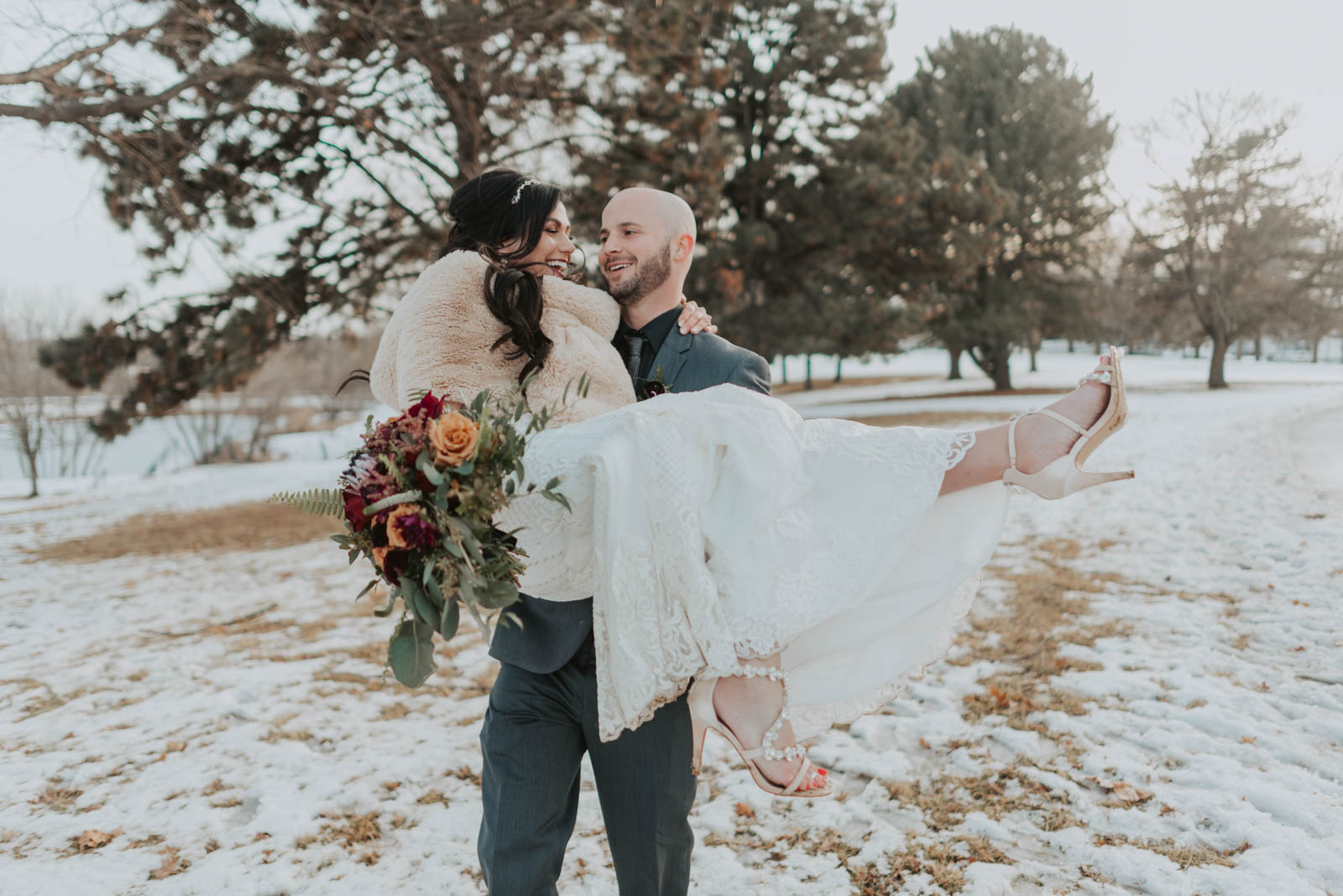 bride and groom couples photos in the snow at wedding in omaha, nebraska