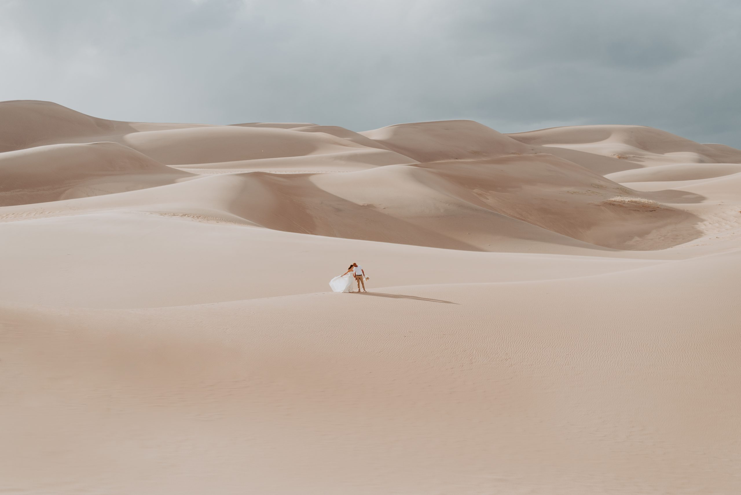 katie and cale summer engagement session at the great sand dunes in alamosa colorado