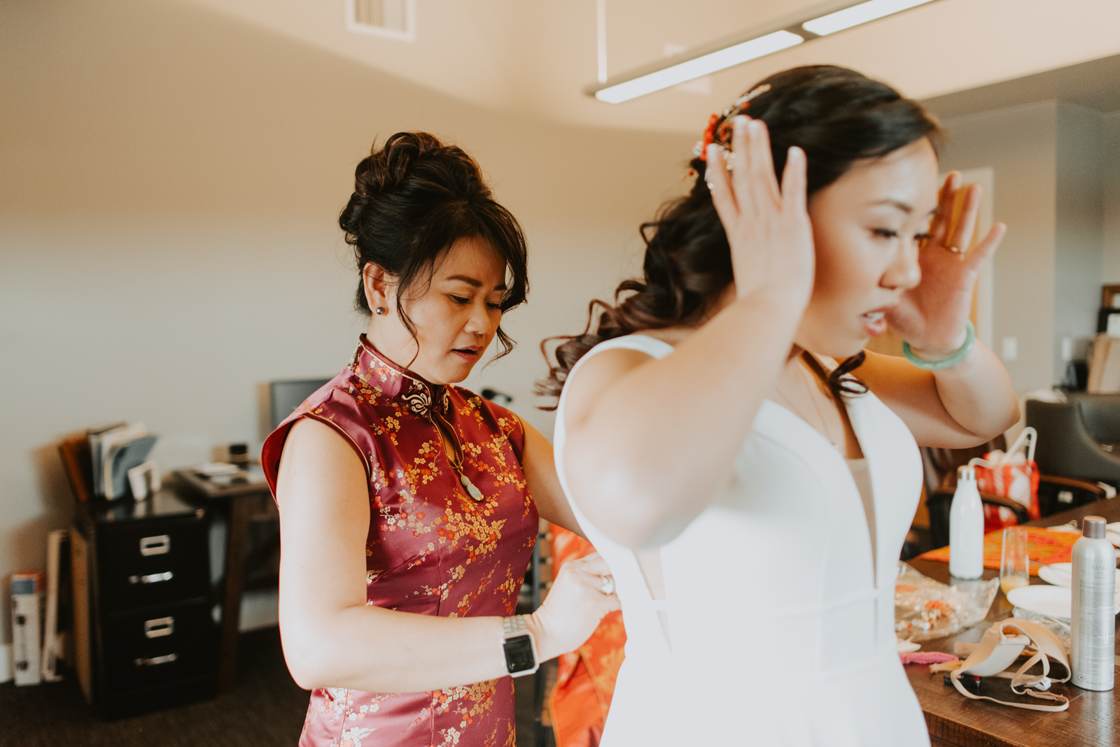 bride gets ready with her mother for her sunset elopement in littleton colorado