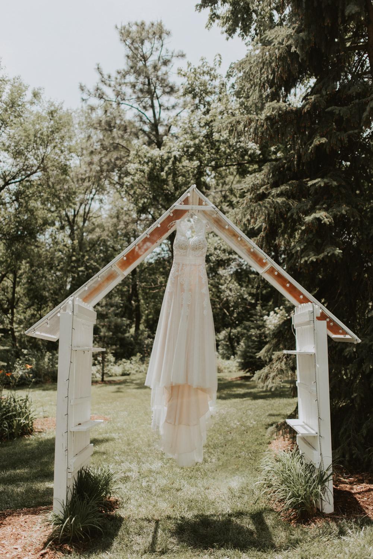 bridal wedding dress on ceremony altar in lincoln, nebraska