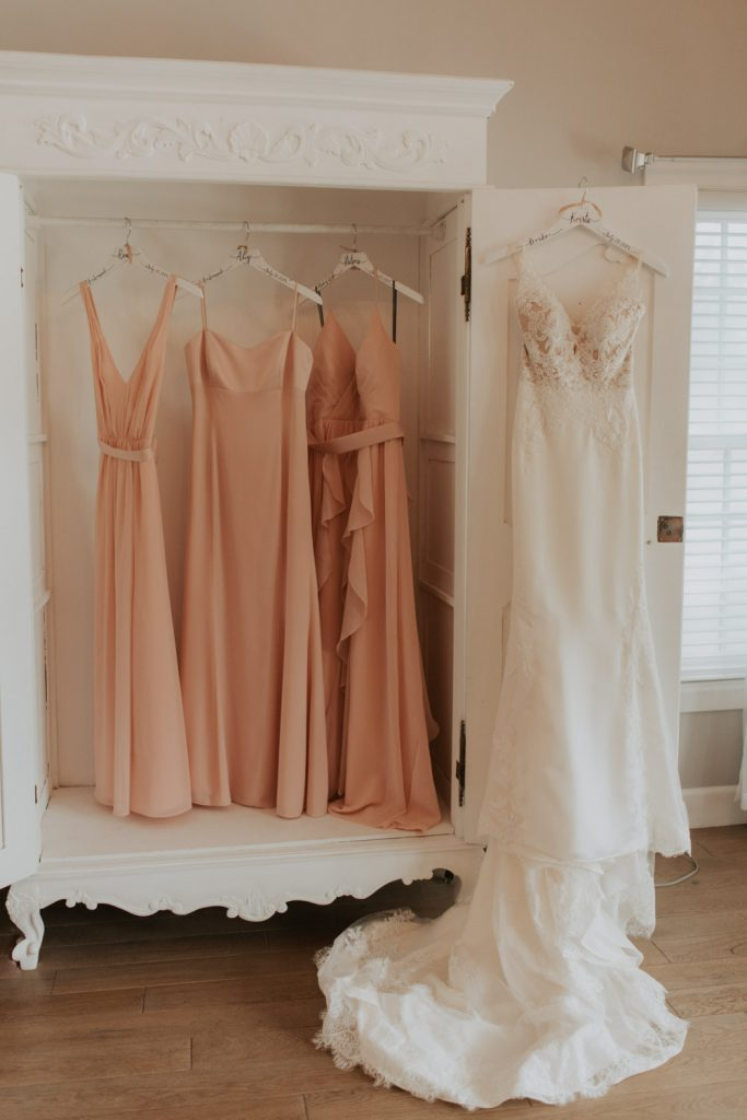 getting ready details dresses with bridal florals photos from wedding reception at the barn at raccoon creek in ken caryl denver colorado