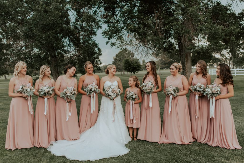 bridesmaids and bride group photos from wedding at racoon creek in denver, colorado