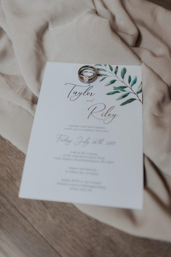 invites and rings details from omaha nebraska barn at ackerhurst wedding
