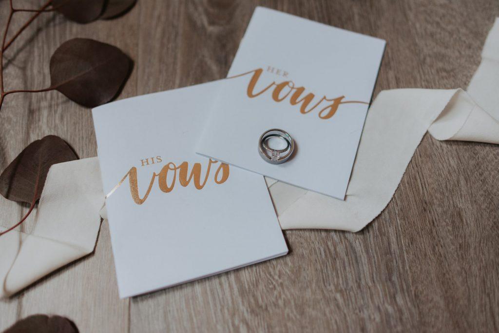 vow books and rings details from omaha nebraska barn at ackerhurst wedding
