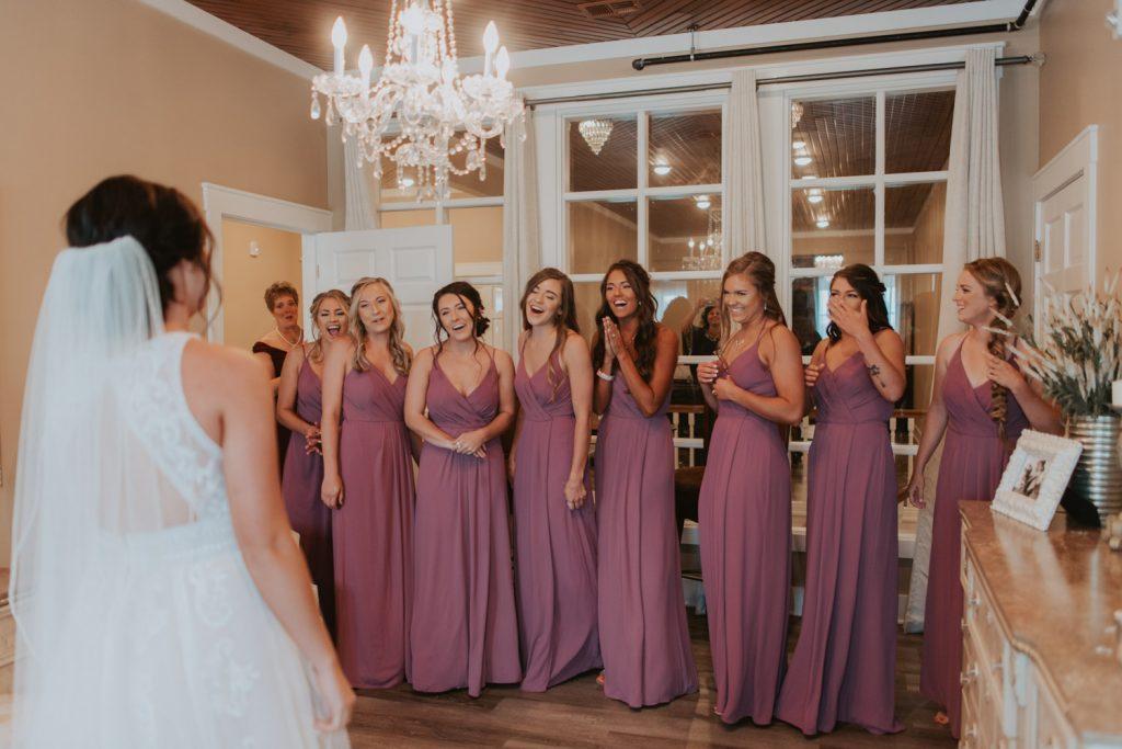 bridal party first look from omaha nebraska barn at ackerhurst wedding