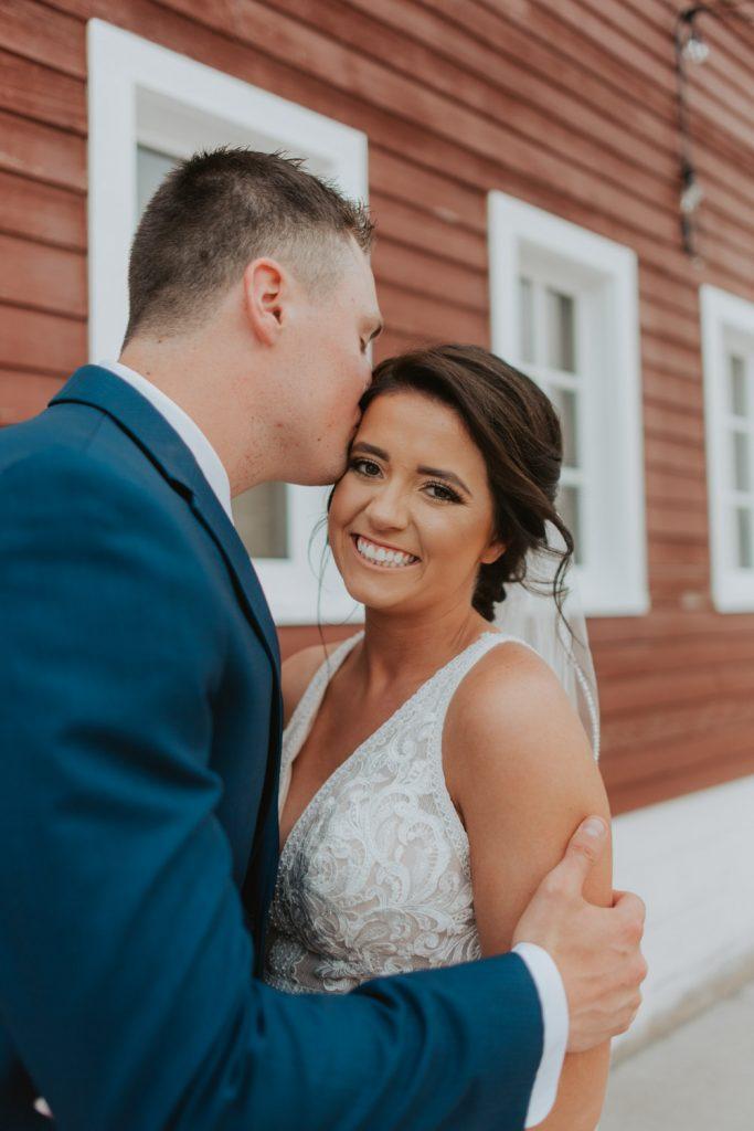 first look with bride and groom from omaha nebraska barn at ackerhurst wedding