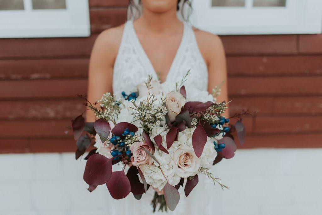 bride and bridal bouquet from omaha nebraska barn at ackerhurst wedding