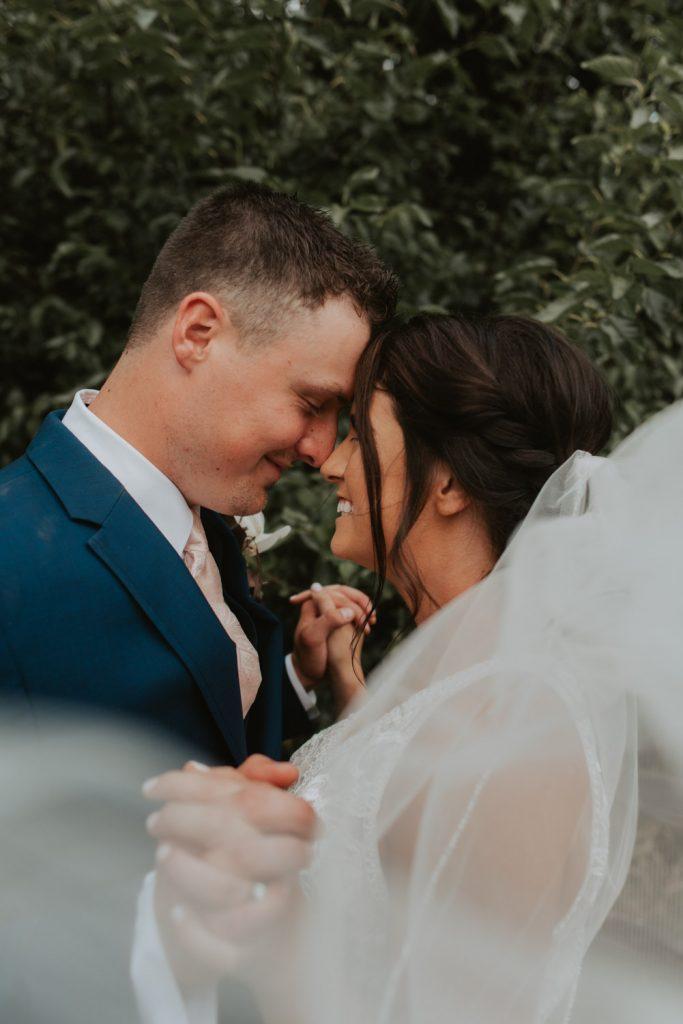bride and groom from omaha nebraska barn at ackerhurst wedding