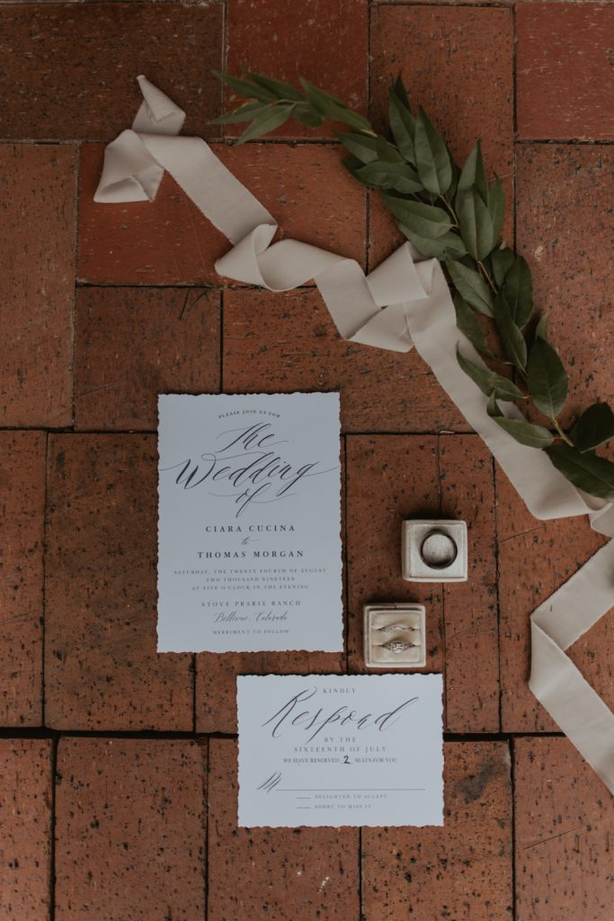 wedding invite and floral details at wedding in belleview fort collins colorado