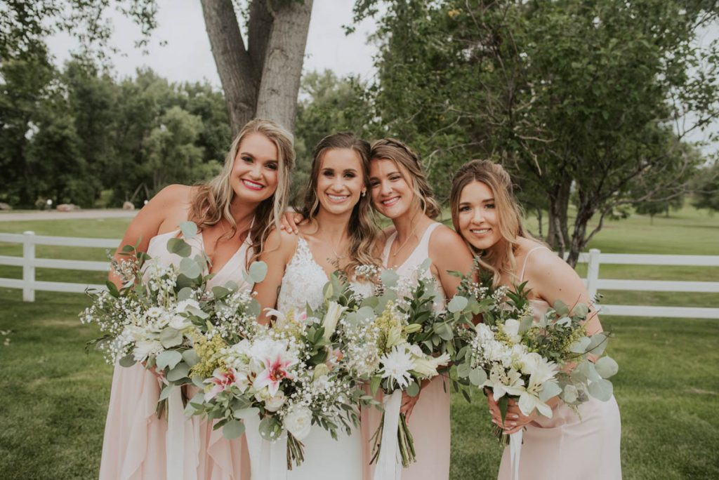 bridal party from wedding at raccoon creek in littleton colorado