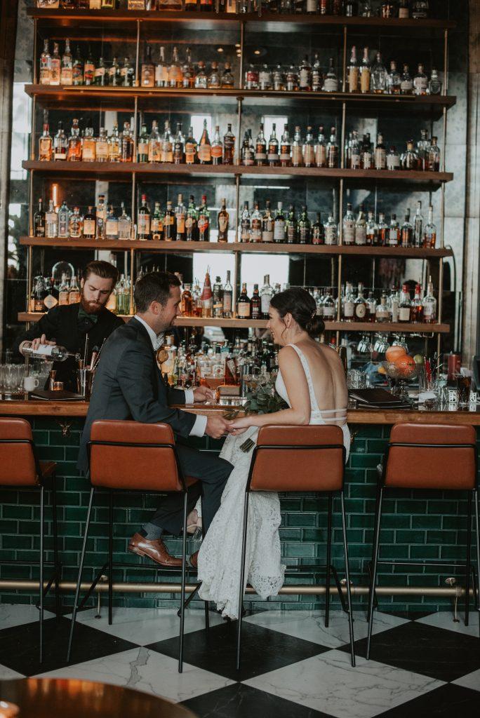 bride and groom having drinks at monarch bar at hotel deco in omaha nebraska