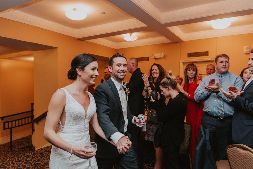 bride and groom entering reception at the paxton ballroom in omaha nebraska