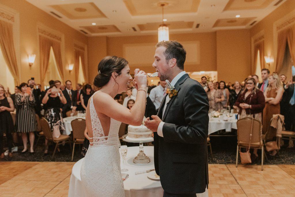 bride and groom cutting cake at the paxton ballroom in omaha nebraska