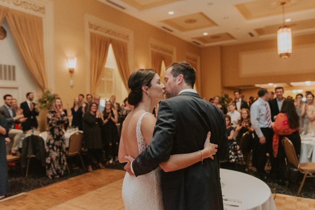 bride and groom kiss at the paxton ballroom in omaha nebraska