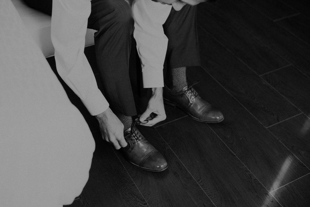 groom getting ready at hotel deco in omaha nebraska