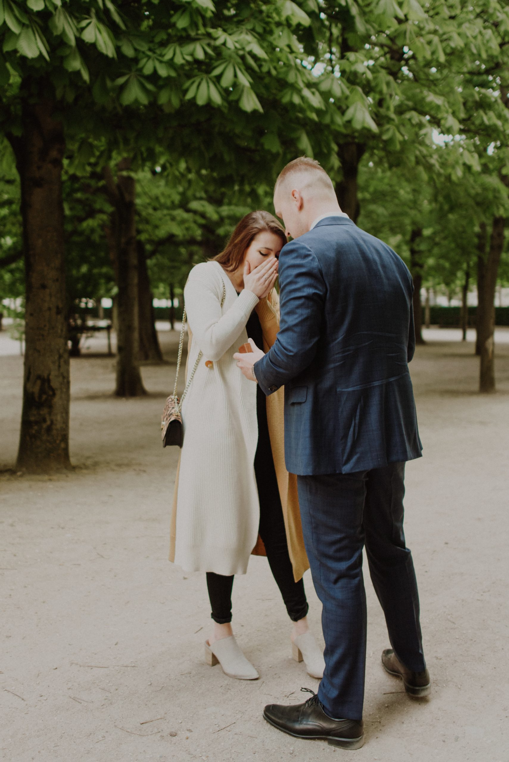 proposal in front of the louvre museum in paris france inside the tuileries garden in spring