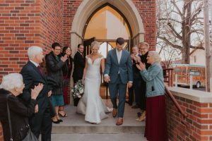 bride and groom formal exit from church from wedding day in lincoln nebraska