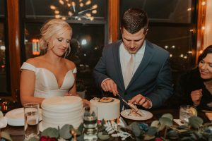 bride and groom cake cutting from wedding day in lincoln nebraska