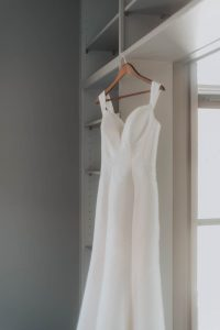 brides dress hanging while getting ready for wedding day in lincoln nebraska