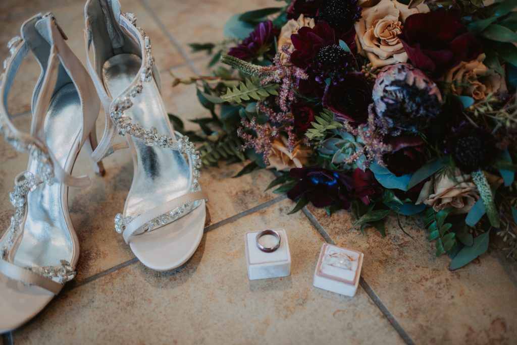 brides bouquet, shoes and jewelry details from anna and daniels wedding in omaha nebraska