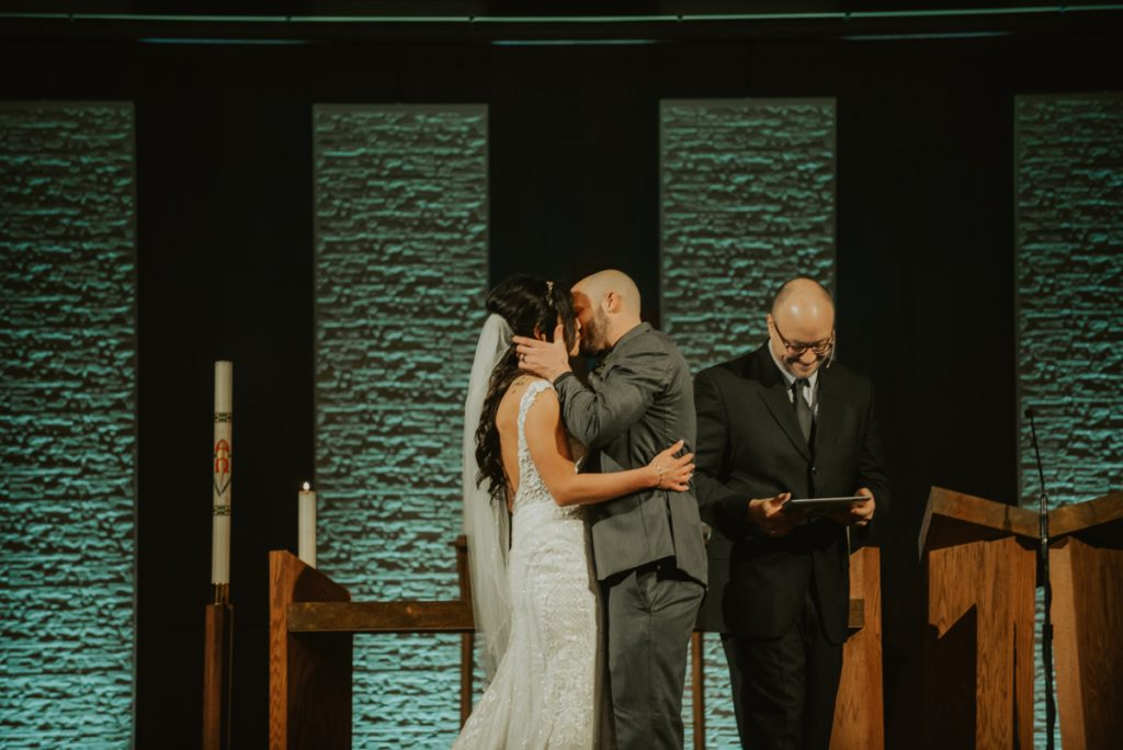 bride and groom at altar from anna and daniels wedding in omaha nebraska