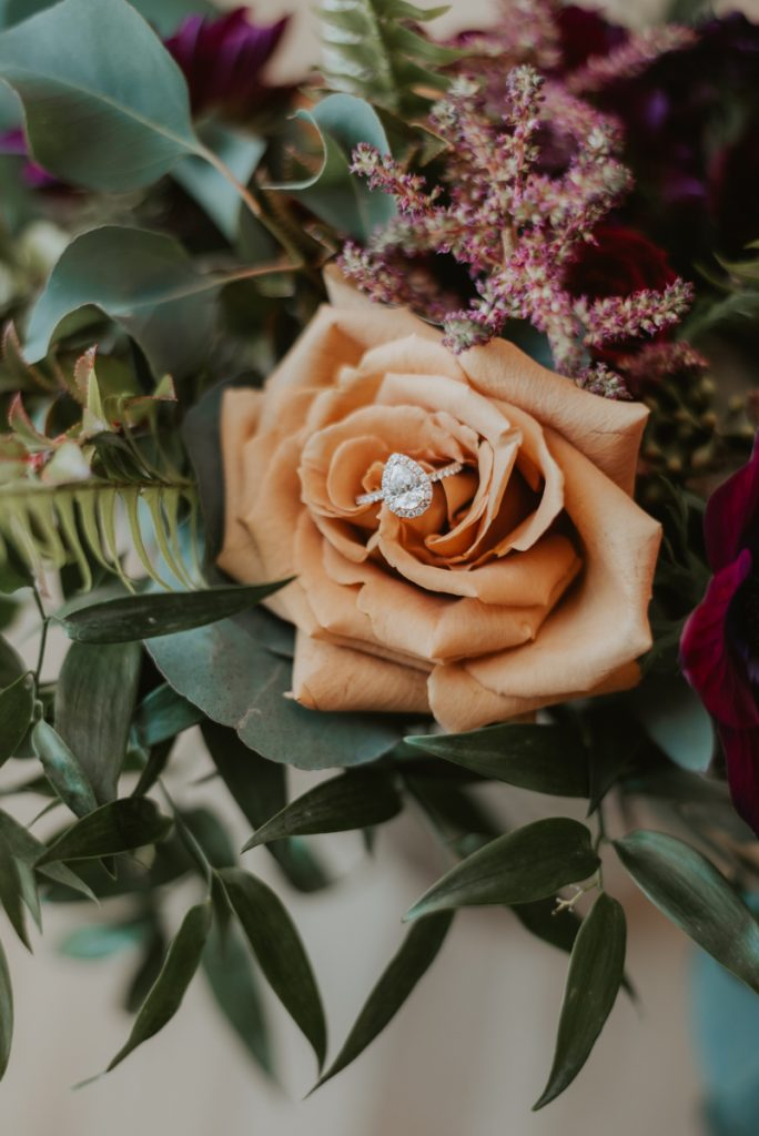 engagement ring in bridal bouquet from anna and daniels wedding in omaha nebraska