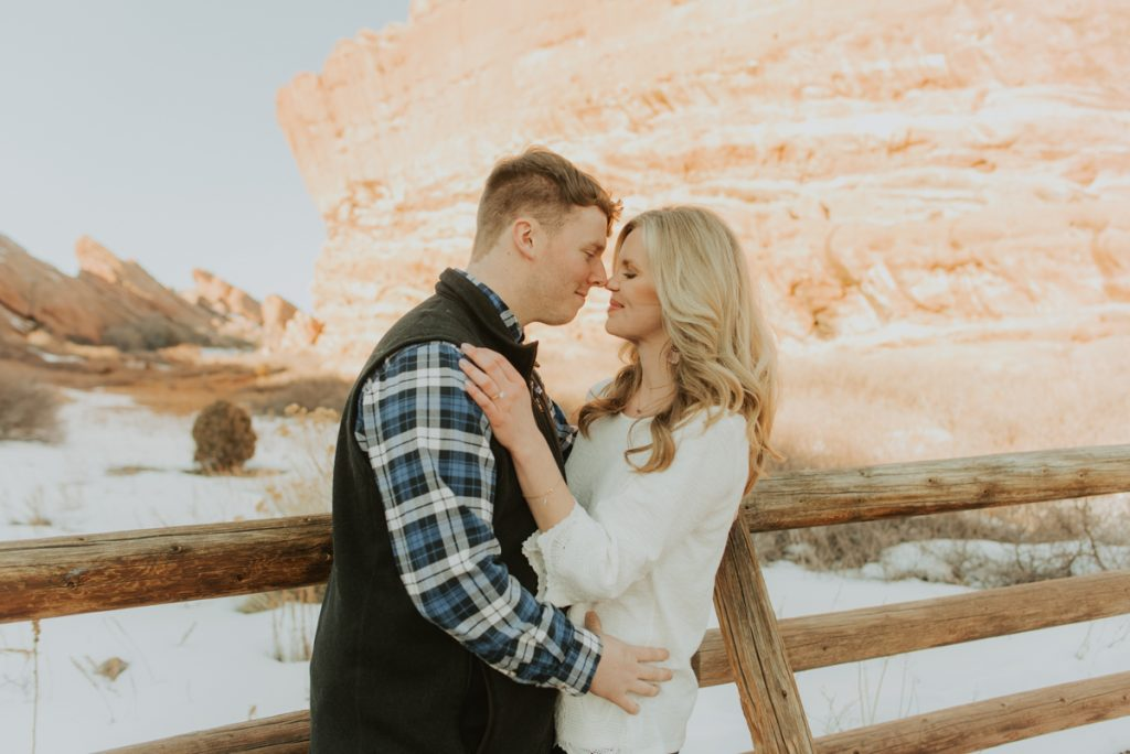 carrie beth and luke at their engagement session at red rock park in denver colorado