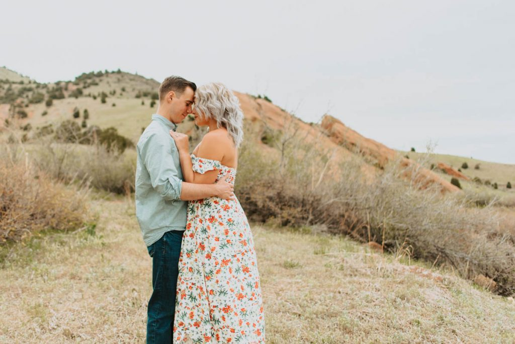 carrie and tylers springtime engagement photos from red rocks in morrison, colorado