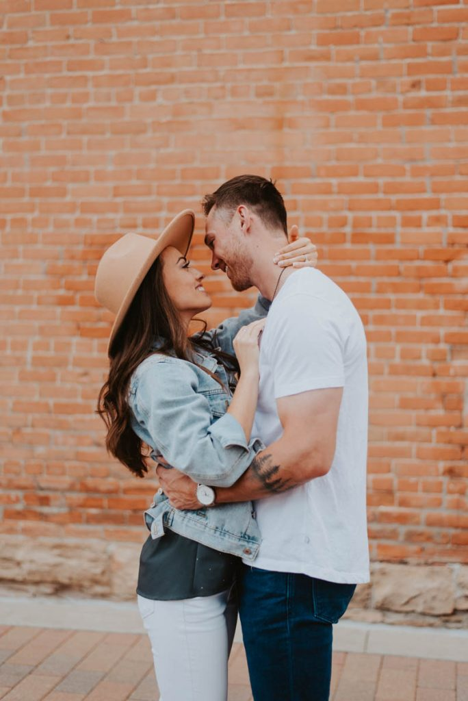 sydney and wills spring engagement session in old town fort collins colorado