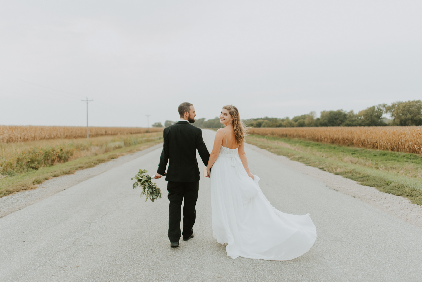 taylor and tylers bridal portraits at their hillside wedding at wishing hills barn in iowa